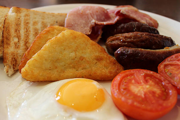 Image showing fried English breakfast, with sausage, bacon and egg stock photo