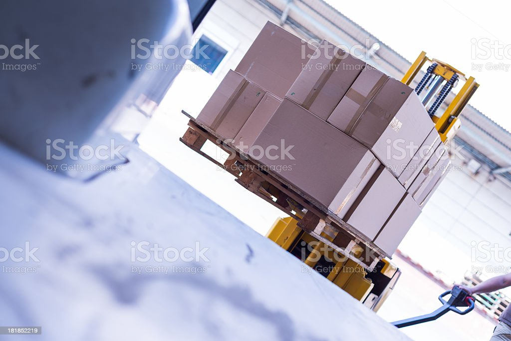 Image taken on angle from inside of a truck as it is loaded royalty-free stock photo