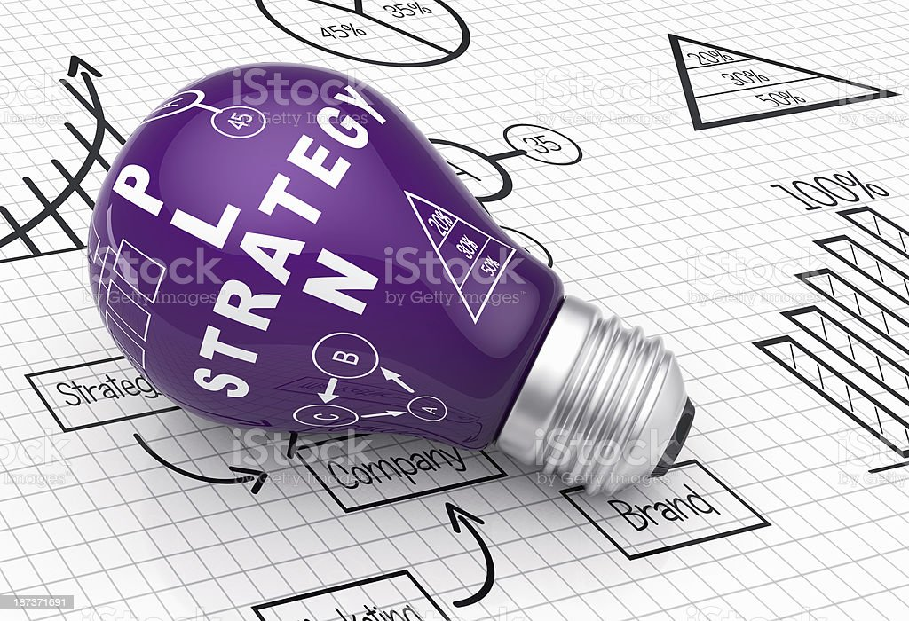 Image with a purple light bulb on a graphing paper stock photo