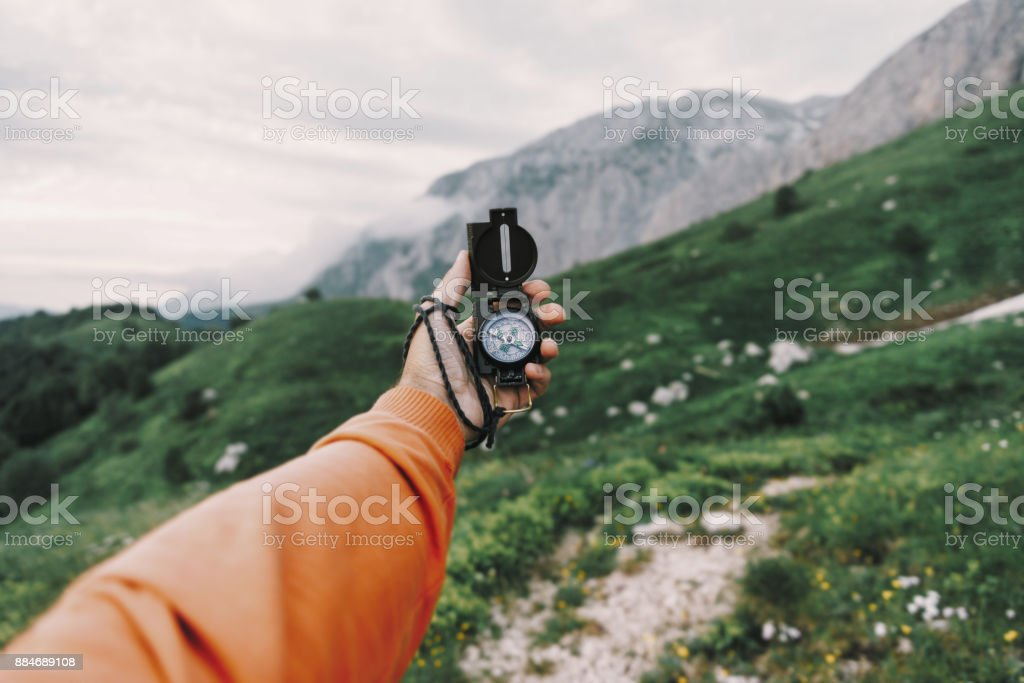 POV image with compass outdoor. stock photo