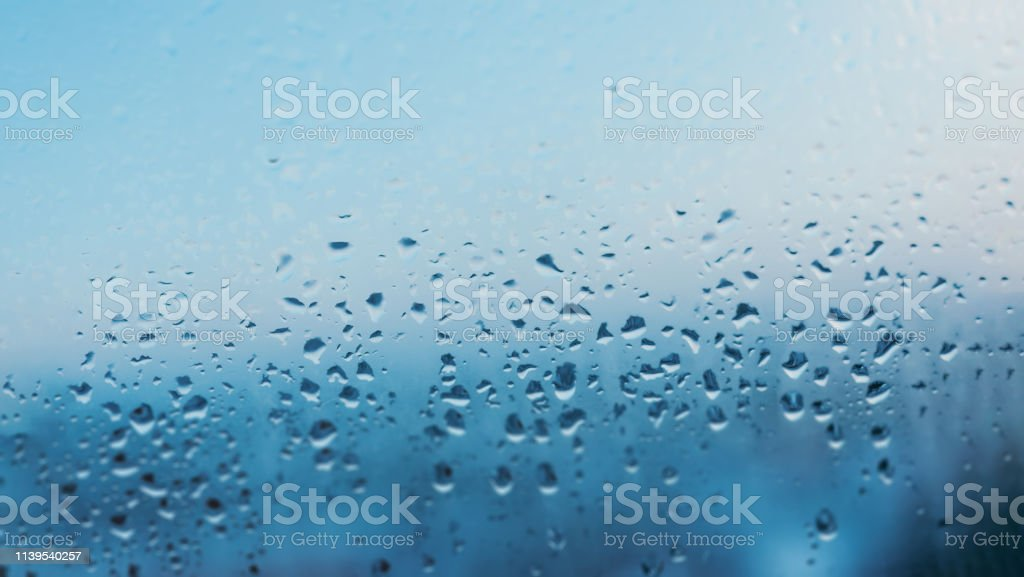 Image with condensation formed by water droplets on glass due to poor...