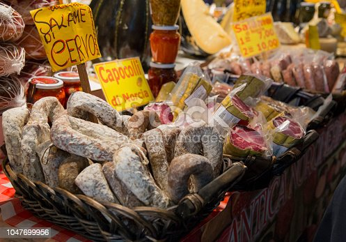 image with detail of wicker baskets with typical Italian salami of wild boar and deer
