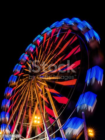 istock Image with the ferris wheel at night in a park of distractions 1162185350