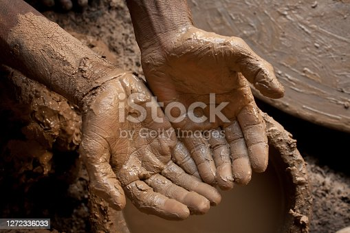 A image with top view showing the hands of a craftsman.