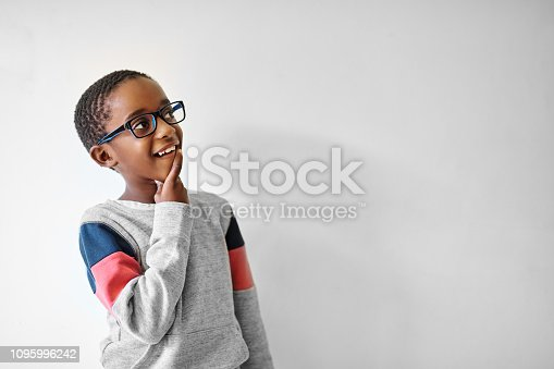 Shot of an adorable little boy looking away thoughtfully