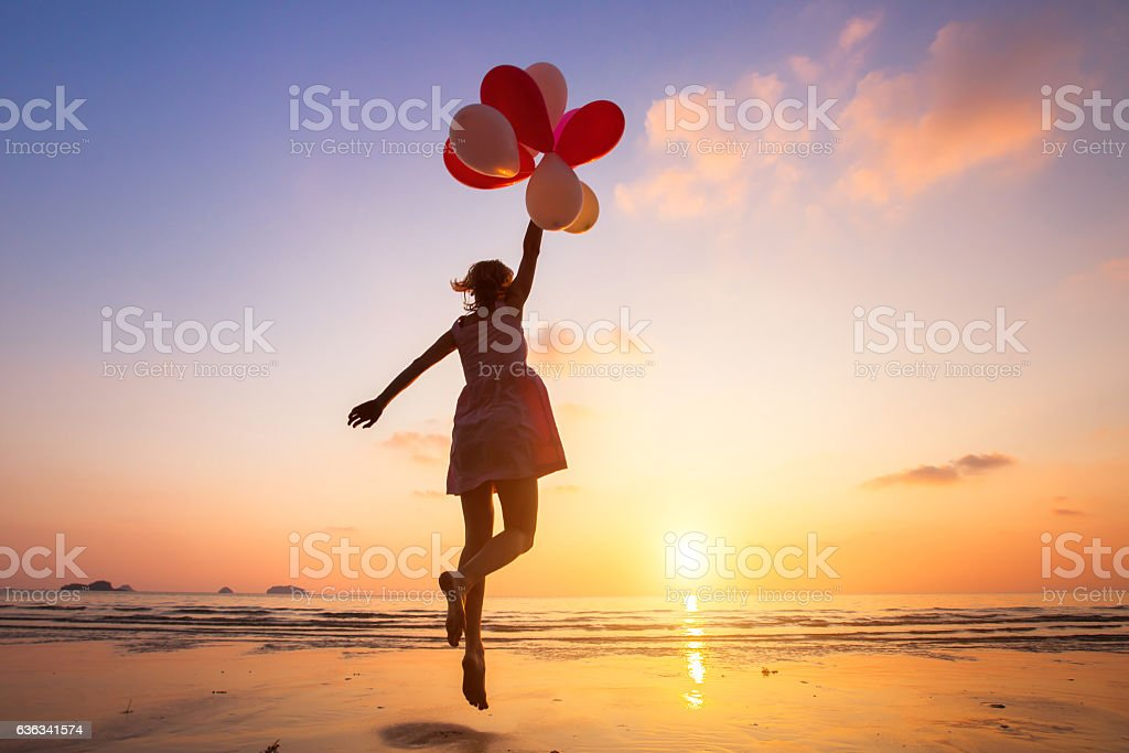 imagination, happy girl flying on multicolored balloons, dreamer stock photo