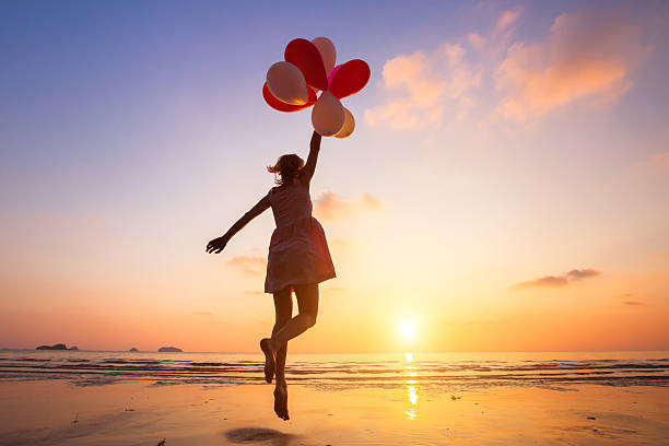 imagination, happy girl flying on multicolored balloons, dreamer - dreamlike stock photos and pictures