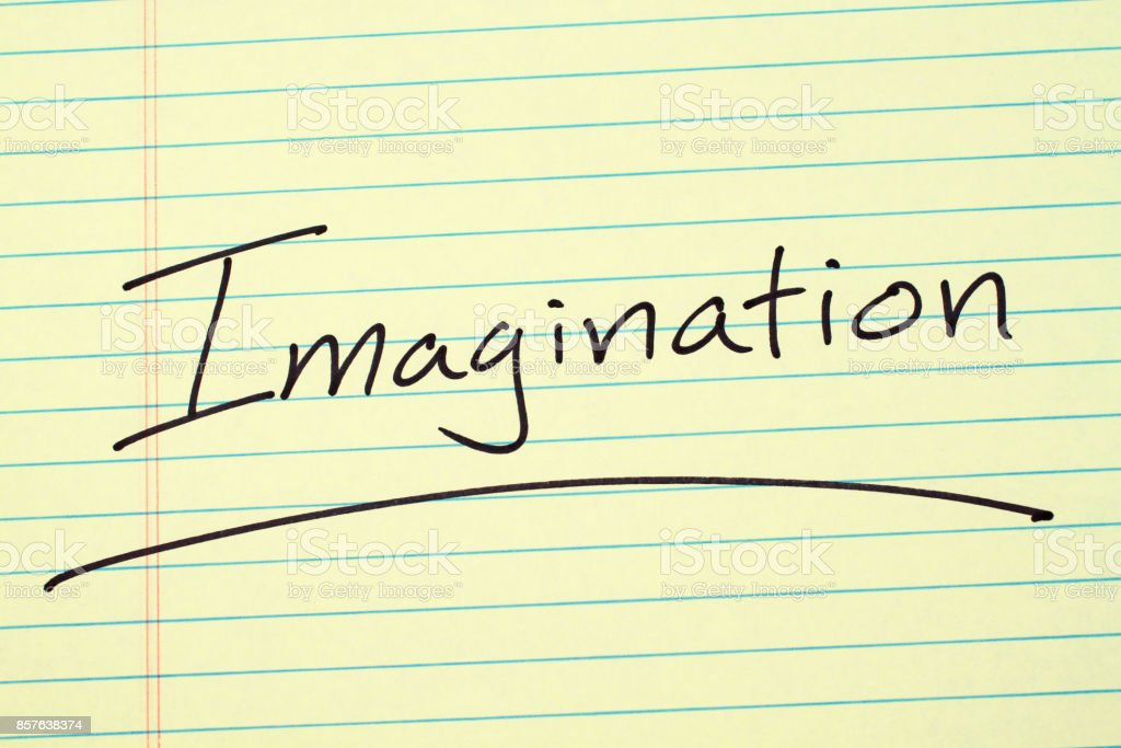 Imagination On A Yellow Legal Pad stock photo