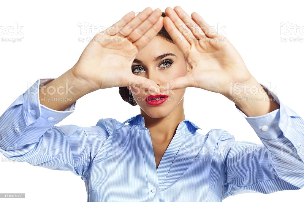 Imagination Portrait of attractive businesswoman standing against white background and making a frame with hands.  20-24 Years Stock Photo