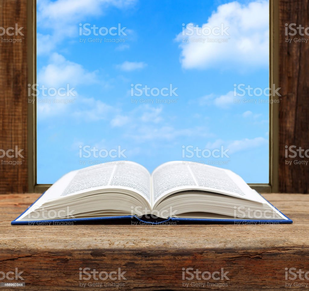 imagine concept book page open window sky view stock photo