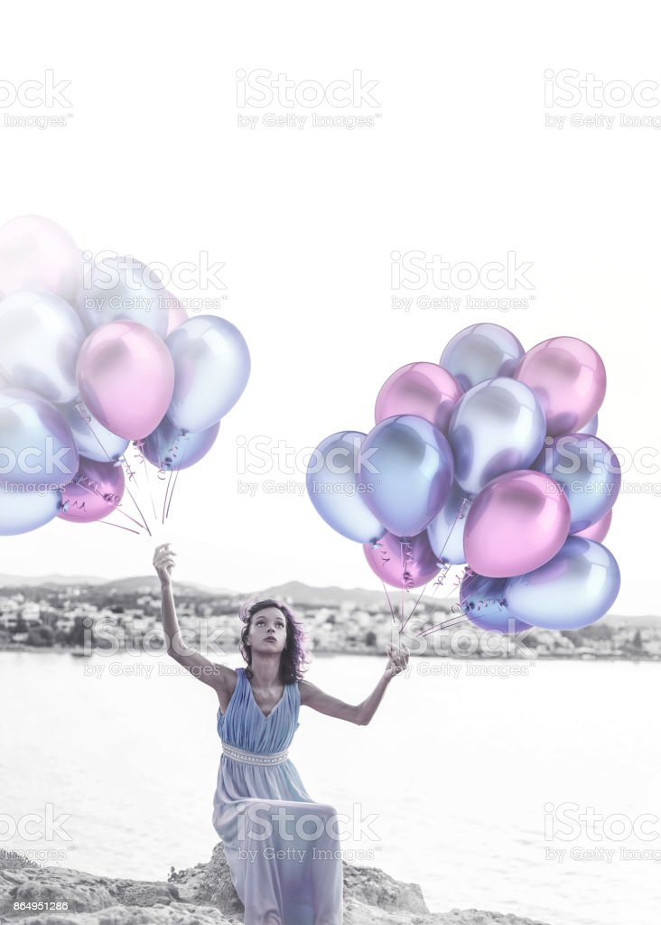 Imagined woman with balloons stock photo