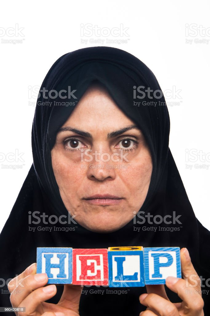 Immigrant muslim Woman asking for Help stock photo