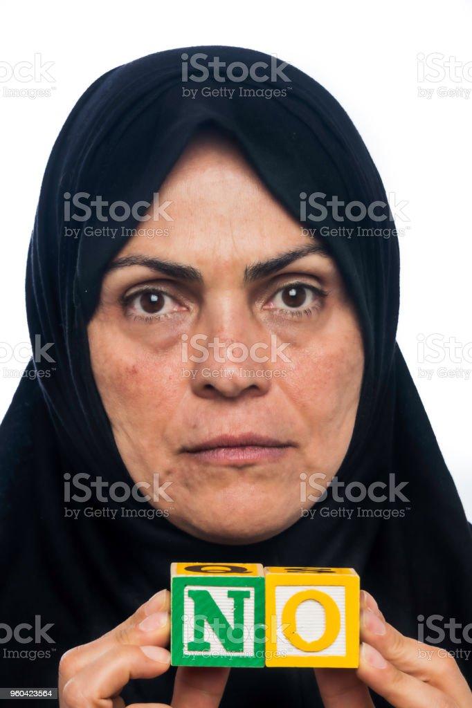 Immigrant muslim Woman saying NO stock photo