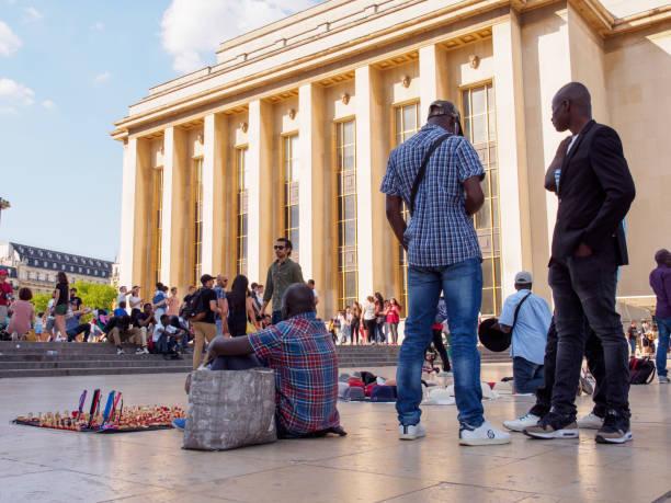 Immigrant street vendors sell souvenirs, Paris, France stock photo