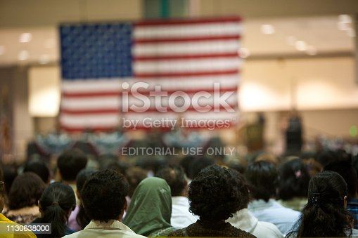 Los Angeles, California, USA - June 22, 2007: Immigrants of many ethnic backgrounds appear at a swearing in ceremony for US citizenship. Photo taken at the US Court's public citizenship ceremony at the LA Convention Center.