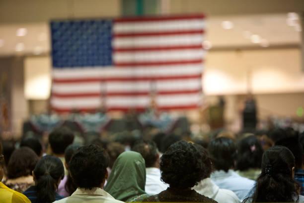 immigrants at a swearing in ceremony - cittadino foto e immagini stock