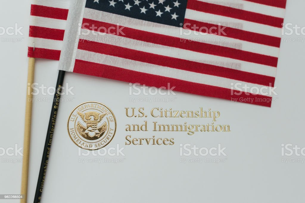 Immigration and Citizenship Gold Embossed Logo stock photo
