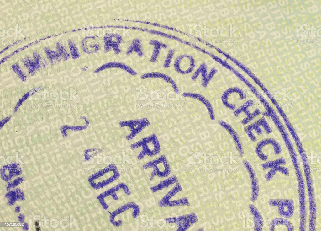 Immigration Arrival stamp in a British passport royalty-free stock photo
