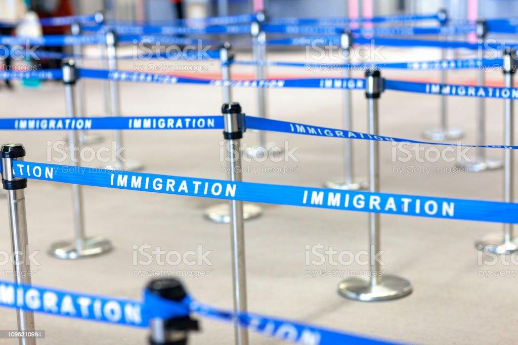 immigration board line immigration board line Adult Stock Photo