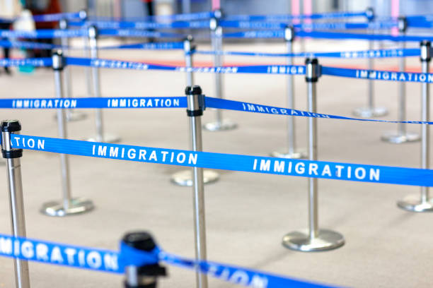 immigration board line immigration board line immigrant stock pictures, royalty-free photos & images