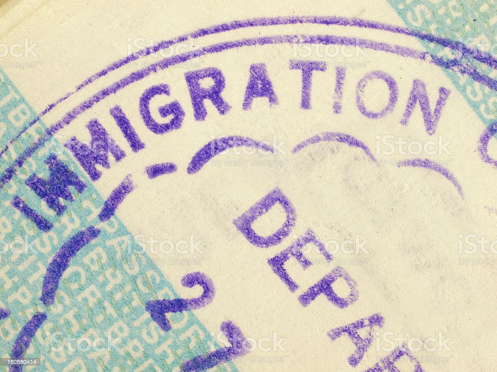 Immigration Departure stamp in a British passport royalty-free stock photo