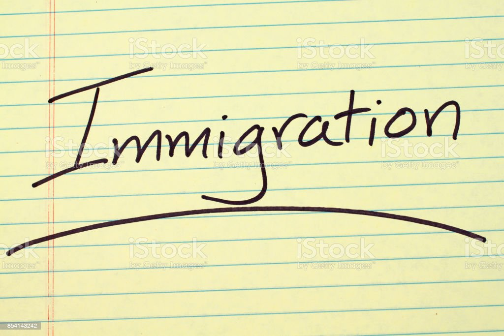 Immigration On A Yellow Legal Pad stock photo