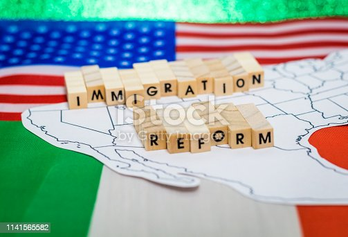istock Immigration Reform concept on US-Mexico border map with United States and Mexico flags 1141565582