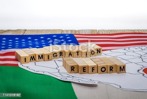 istock Immigration Reform concept on US-Mexico border with United States and Mexico flags 1141018162
