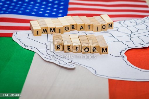 istock Immigration Reform concept on US-Mexico border with United States and Mexico flags 1141019436