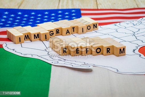 istock Immigration Reform concept on US-Mexico border with United States and Mexico flags 1141020098
