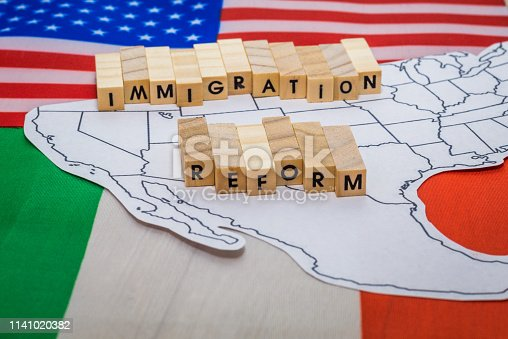 istock Immigration Reform concept on US-Mexico border with United States and Mexico flags 1141020382