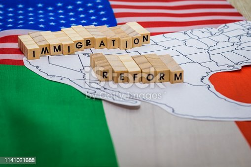 826166958 istock photo Immigration Reform concept on US-Mexico border with United States and Mexico flags 1141021688