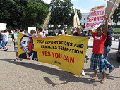 Washington DC, USA-July 24, 2013:  These protesters march in front of the White House in Washington DC to ask president Barack Obama to stop deporting latinos.  Under his administration 1.7 million latinos have been deported-more than any other president.