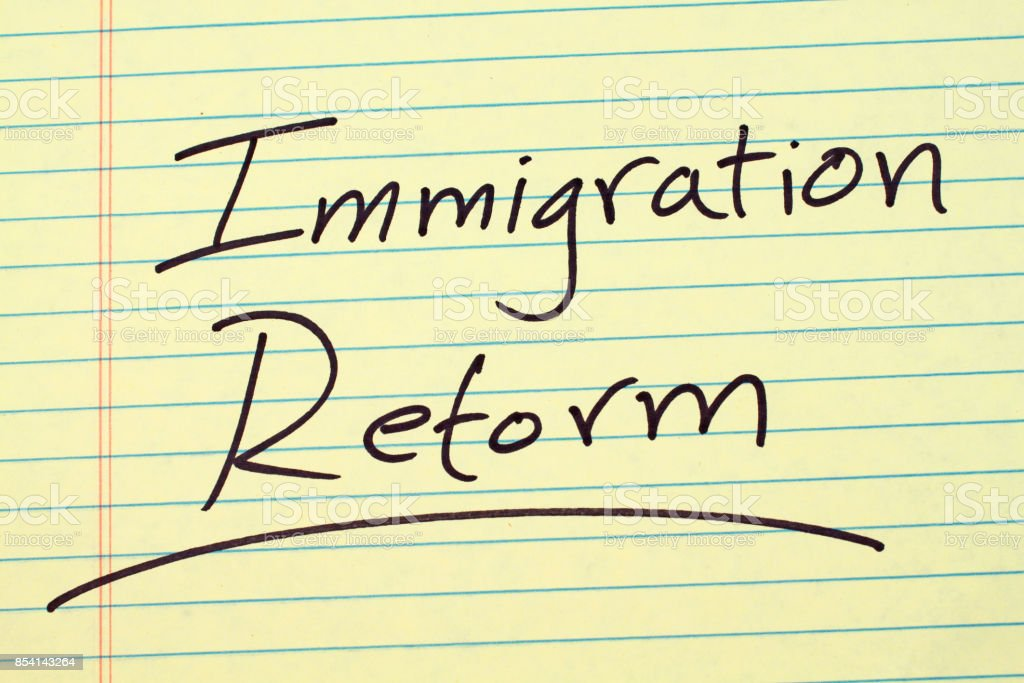 Immigration Reform On A Yellow Legal Pad stock photo