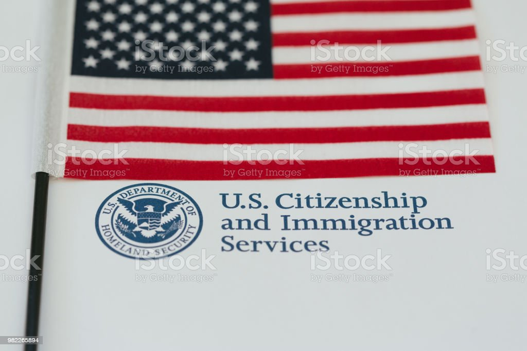 US Immigration stamp and flag stock photo