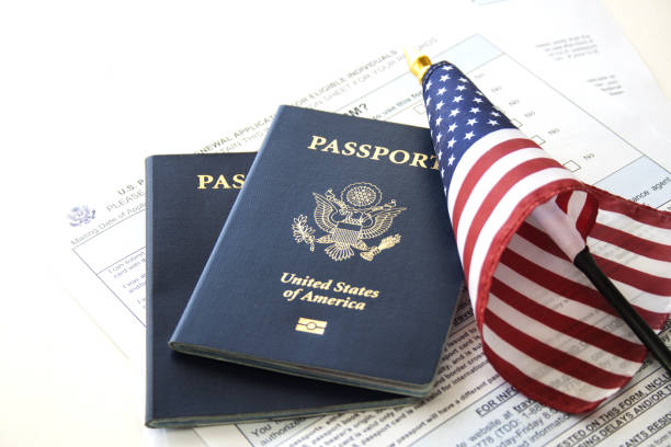 Immigration/travel concept US Passports with flag and renewal forms citizenship stock pictures, royalty-free photos & images