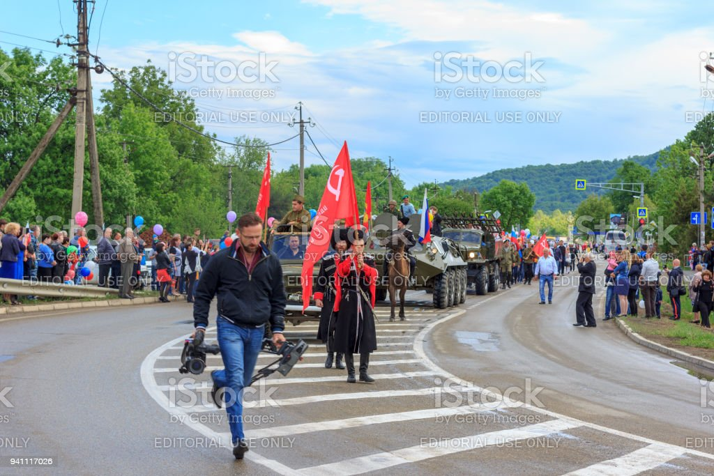 Adygea, Russia - May 9, 2017: Immortal regiment, Parade on victory day with the participation of schoolchildren, Cossacks and military equipment stock photo