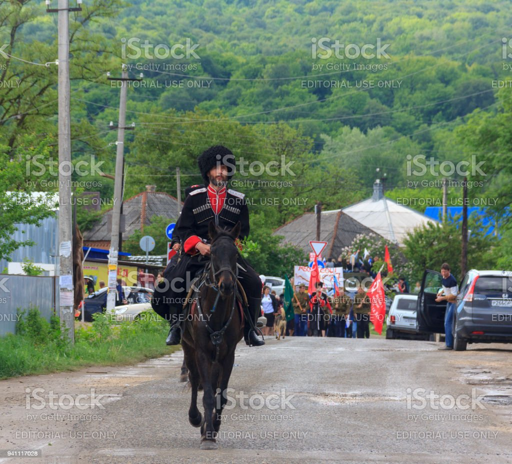Adygea, Russia - May 9, 2017: Immortal regiment, Parade on victory day with the participation of schoolchildren and Cossacks stock photo