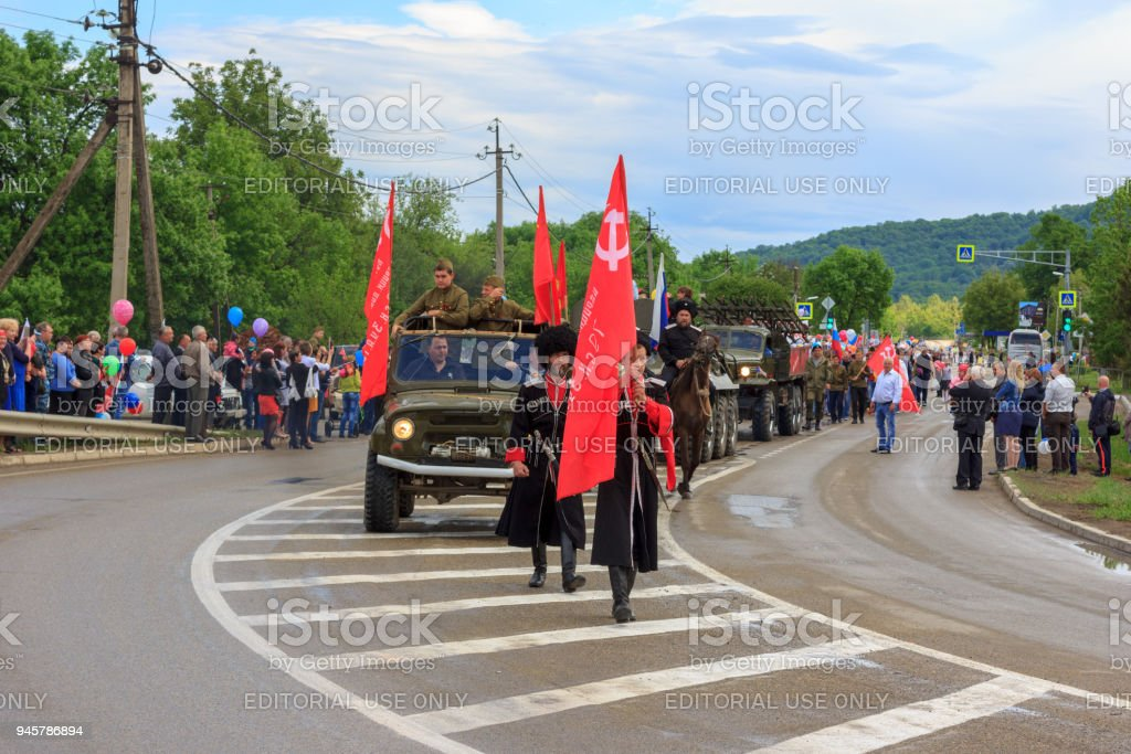 Immortal regiment, Parade on victory day with the participation of schoolchildren, Cossacks and military equipment stock photo