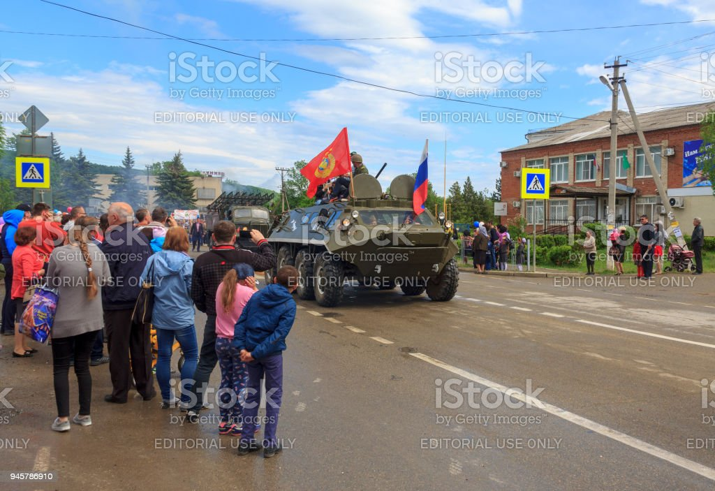 Immortal regiment, Parade on victory day with the participation of schoolchildren and military equipment stock photo