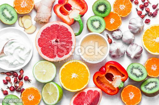Immunity  boosting food set on a light background . Healthy lifestyle concept, winter prevention of colds. Flat lay, top view