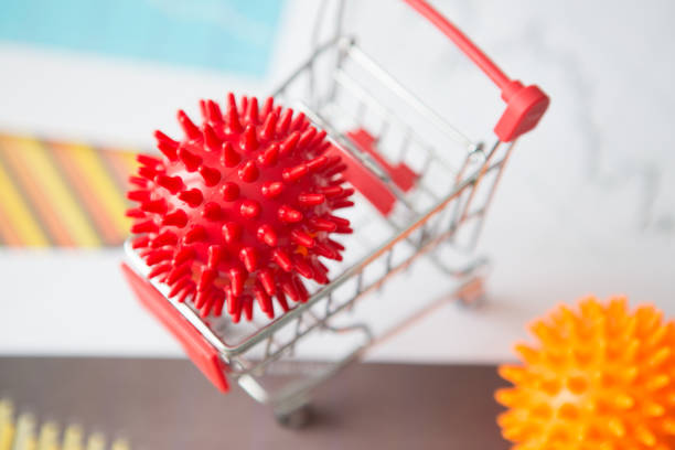 Impact of coronavirus COVID-19 on the global economy, Coronavirus in a shopping trolley. Financial crisis 2020. stock photo