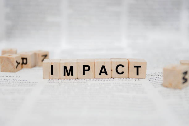 Impact Word Written In Wooden Cube - Newspaper stock photo