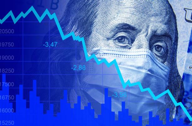 COVID-19 impacts to business, dollar money and graph of stock market crash during coronavirus pandemic. World economy hits by novel corona virus. stock photo