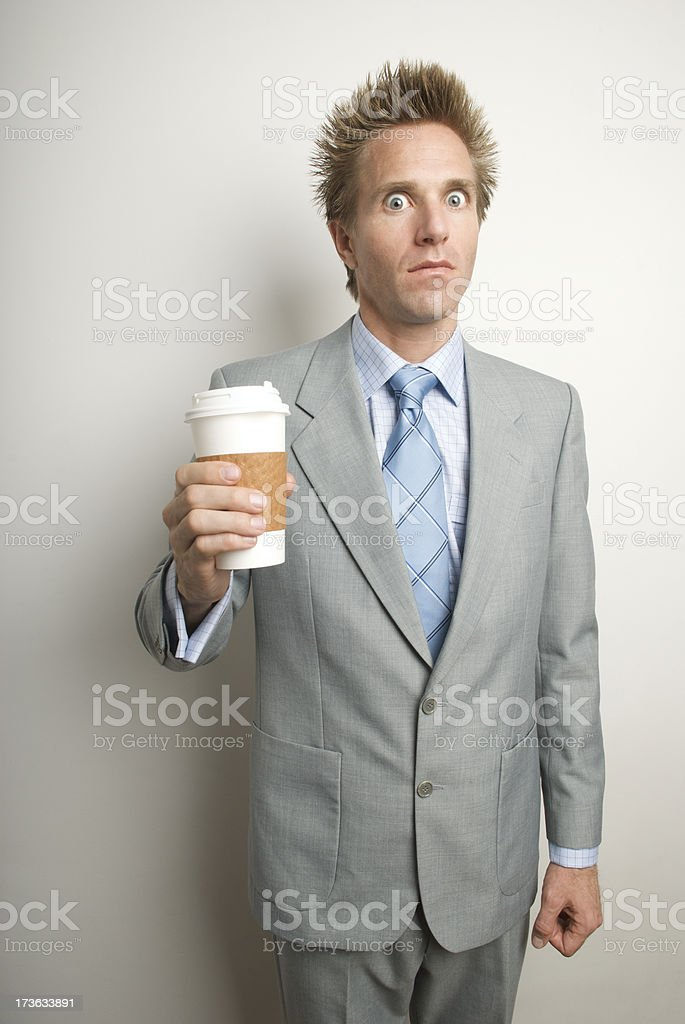 Impatient Caffeine Addicted Businessman Holding Coffee Cup royalty-free stock photo