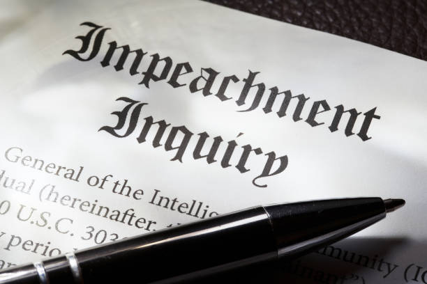 Impeachment Inquiry: Concept with document and gavel stock photo
