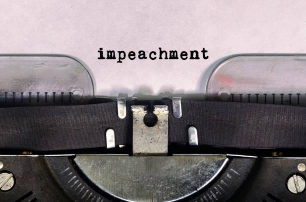Impeachment Text Type on Vintage Typewriter stock photo