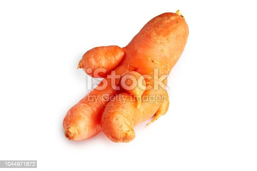 Imperfect fresh organic carrot isolated on white background