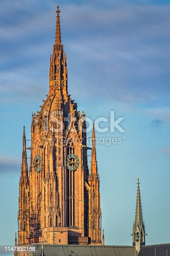 Stock photograph of the Gothic tower of the historic Kaiserdom in downtown Frankfurt am Main Germany on a sunny day.