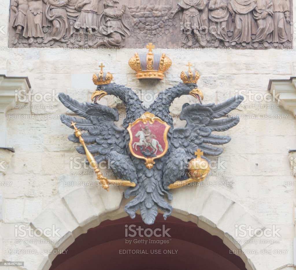 Imperial eagle above the arch of the Bastion fortress stock photo